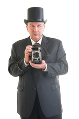 photographer in a retro business suit