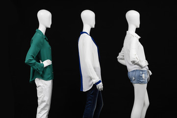 three mannequin in dressed fashionably and isolated