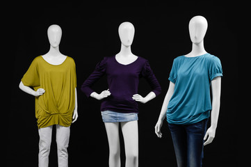 Three mannequin colorful dress