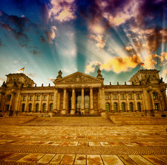 Berlin Reichstag Building in winter . Sunset colors from Platz d