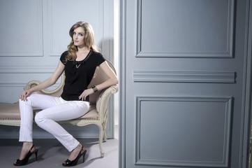 Girl in sitting in old chair studio shoot near door