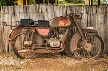 the old, rusty motorcycle