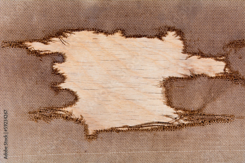 background of burlap with a hole for writing text. texture