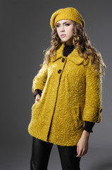 fashionable girl in yellow clothing posing