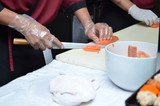 Japanese chef slicing salmon sushi