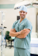 Smiling Surgeon Standing Arms Crossed