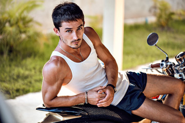 handsome young sporty man relaxed outdoor