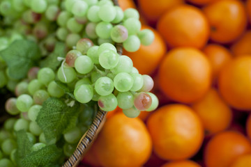 variety of fresh fruits, grapes, oranges