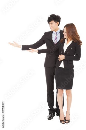 Young smiling businesswoman and businessman with showing gesture