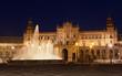 fountain on Plaza de Espana at night, Seville, Spain