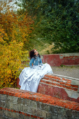Bride in city park