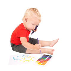 year-old child during painting a sun by brush and watercolours