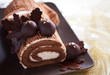 Traditional Christmas Yule Log cake with chocolate chestnuts