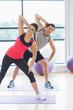 Two people doing power fitness exercise at yoga class