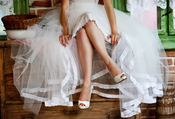 Detail of bridal legs with shoes