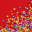 Abstract Colorful beads on red background