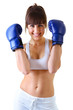 sport young woman with perfect body in boxing gloves, fitness gi