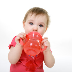 portrait of cute drinking little girl toddler, 10 month