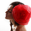 Vintage portrait of fashion glamour girl with red flower in her