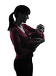 woman mother hugging baby silhouette
