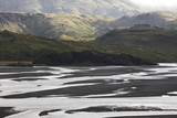 Iceland. East fjords. Lonsvik. Water and sand from glaciers.