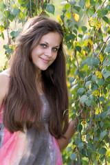 Teen girl near the birch