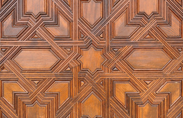 Arabic wooden door in the Alhambra in Granada, Spain