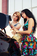 Young women loading shopping bags in a car trunk