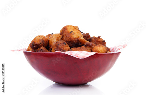 Bowl with Pile of Dutch donut also known as oliebollen, traditio