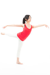 young asian woman exercising on white background