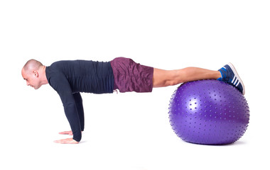 Sport man exercise with a pilates ball