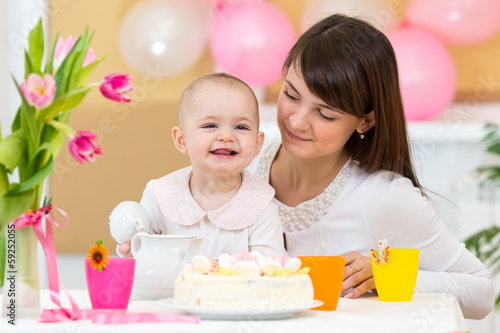 baby and mother celebrate  first birthday