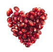 Heart of pomegranate seeds on white background