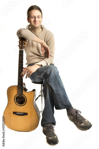 Smiling young guitarist
