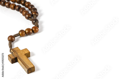 wood rosary with cross at left border