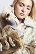 Beautiful blond woman in Mink Fur Coat.winter fashion.Girl