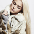 Beautyful blond woman Girl in Mink Fur Coat.winter fashion
