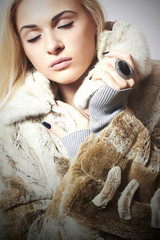 Beauty blond Model Girl in Mink Fur Coat.Beautiful Woman
