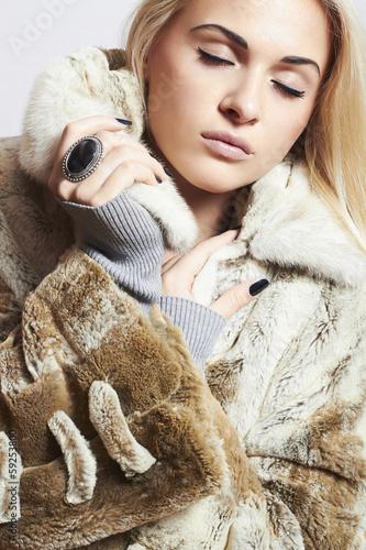 Beautiful blond woman in Mink Fur Coat.winter fashion.Girl