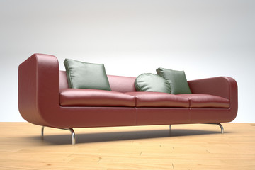 Red leather sofa and green cushions