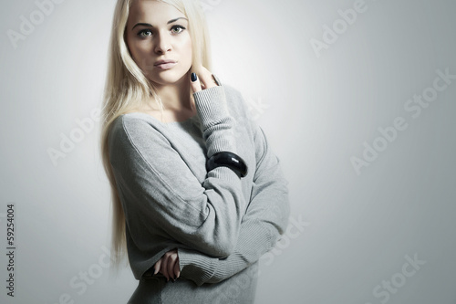 Beautiful blond woman in dress.accessories.flirt.fashion