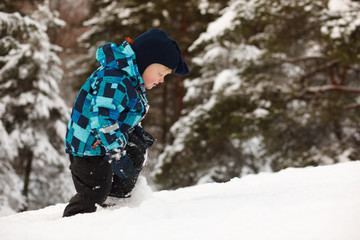 Little boy in deep snow