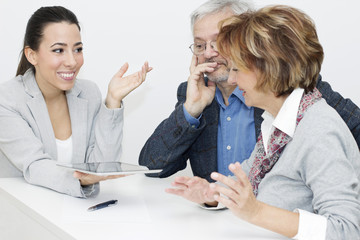 Mature Couple in Meeting With Financial Advisor
