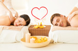 couple getting massage in spa salon