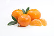 three tangerines and a peeled chunks