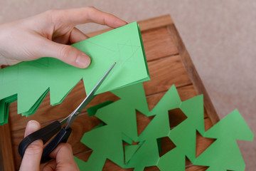 Making a paper chain of Christmas trees