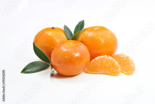 three tangerines and a peeled chunks