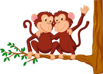 Two monkeys sitting on a tree