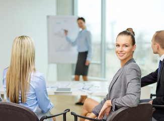 businesswoman with team showing in office