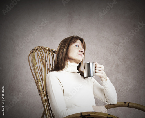 Daydreaming woman in a rocking chair having a break